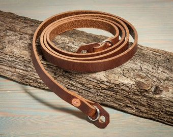 Hand made chestnut leather camera strap with copper rivets.