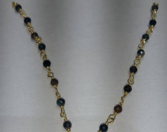 SGR107 one foot  2mm to 2.5 mm black tiger eye gold plated  rosary chain /wire wrapped chain  .