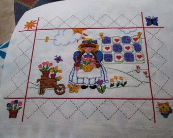 Girl with Braids and Quilt Cross-Stitch