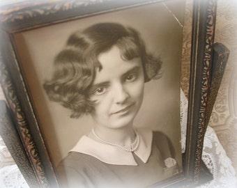 vintage swing frame . deco era gesso wood frame with portrait . dark umber with silver