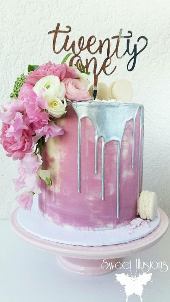 21st Birthday Cake Topper reads: twenty one