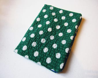 Green cotton wallet has white weight