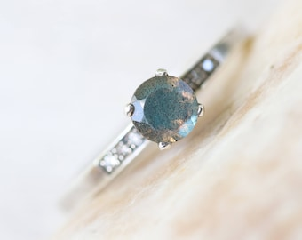 Labradorite and silver cocktail ring with pave set diamonds on either side of the main gem