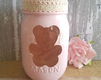 Pint size Mason jar with teddy bear cutout in light pink.
