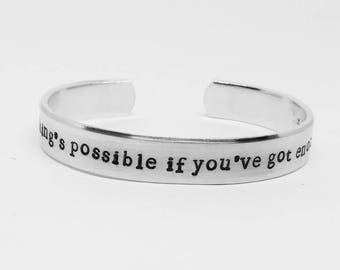 Anything's possible if you've got enough nerve: hand stamped aluminum Harry Potter fandom Ginny Weasley quote cuff bracelet