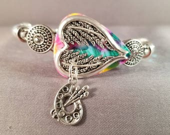"Guitar pick and guitar string bracelet ""Rainbow Angel Wing Heart"""