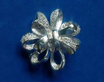 Signed Roman silver tone rhinestone bow pin ,new condition, Vintage
