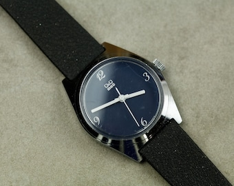 Vintage Q&Q Mechanical Wind Up watch with dark blue dial and white hands black rubber strap