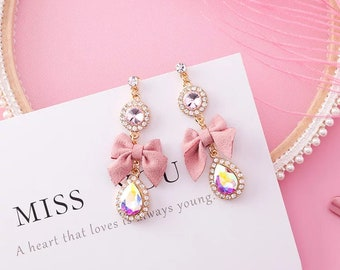pink ribbon bow stud earrings with oval rhinestone