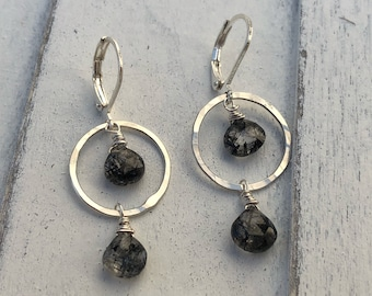 Sterling silver hoops with rutilated quartz.