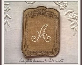 Monogram Augustine ecru linen background