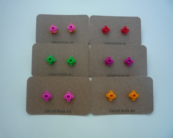 Flower earrings made from lego® brick studs in pink, magenta, red, green, mauve, light blue and yellow. With Hypoallergenic surgical steel.