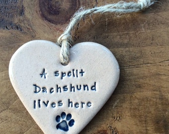 A spoilt Dachshund lives here, handmade ceramic hanging heart, perfect gift