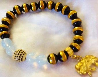 Golden elephant bracelet , bohemian gypsy charmed bracelet , moonstone black and gold bracelet with elephant charm