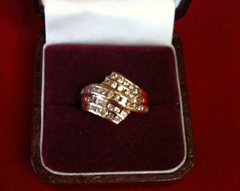 14 K Yellow Gold Ring With Brilliant 38 Diamonds( .75 ct) 5.1 gm. Size 7. We do free Sizing
