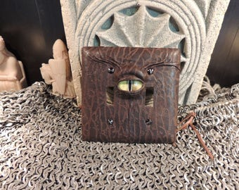Double Light switch cover:Brown Leather and Yellow Eye