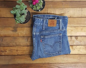 90s Levis low rise Flare jeans size 27xm leather patch