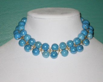 Necklace with three gold filled chains and blue ceramic round beads.