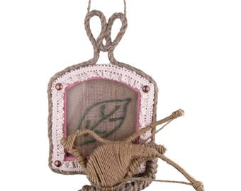 Decorative wooden frame with a bird made of rope