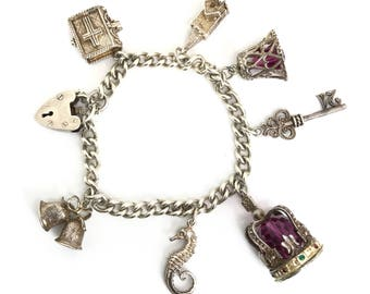 Vintage silver charm bracelet English sterling 7x Charms-Moving-opening-NUVO bible-church-bells-crown-21-seahorse-1973-Heart padlock 44grams