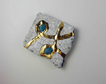 Ceramic brooch, multicolour with gold.