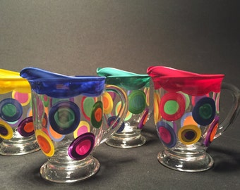 little syrup/cream pitcher with colored rim & polka dots
