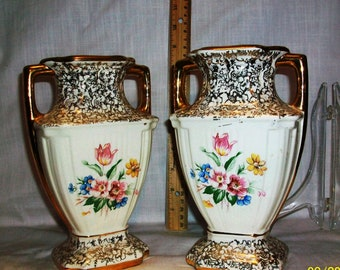 Listing 314 is a pair of vintage warranted 22kt gold brand vases