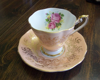 Elegant Salmon Pink and heavy Gold with Roses Royal Standard Teacup and Saucer footed bone china