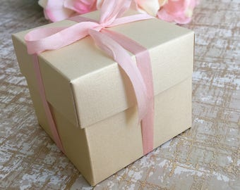 """Customizable champagne gold 2.5""""W x 2.5""""L x 2.25""""H Favor Box With Silk Ribbon  Available in a variety of colors"""