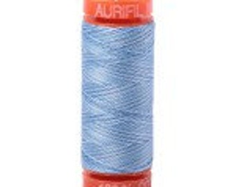blue and white variegated Aurifil Mako Cotton Thread Color 3770, 50 wt, 220yd, 1 spool
