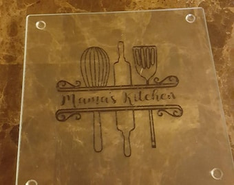 Personalized split monogram kitchen tools glass cutting board. Personalized with any name you'd like.