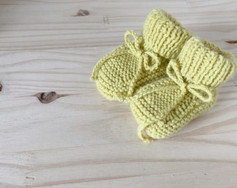 Knit yellow baby booties have