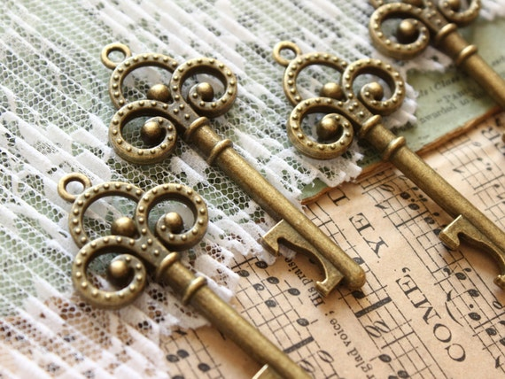 Items similar to skeleton keys bottle openers antique