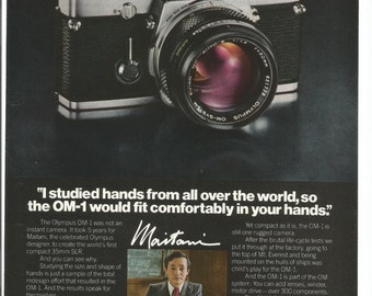 1980 Advertisement Olympus Camera OM-1 Maitani Photography Studio 35mm Film 80s SLR Wall Art Decor
