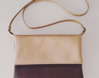 Clutch bag has flap gold and taupe