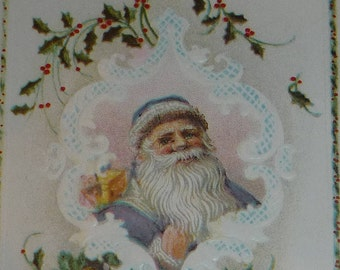 Santa Claus wearing Purple Suit in Vignette Surrounded by Holly Antique Postcard