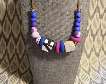 Shades of blues and purples with abstract painted wood cube bead