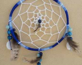 Handmade dream catchers with lapis lazuli and feathers of fagiana