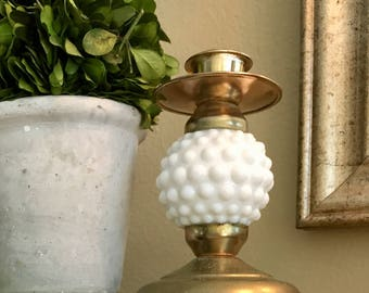 Brass and hobnail milk glass candle holder
