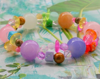 Elastic bracelet with magic beads and various beads