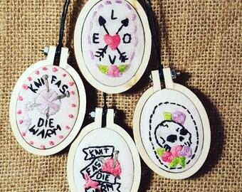 Hoop art embroidered pendants