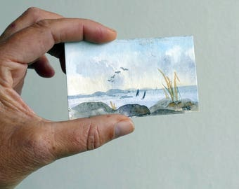 Seascape watercolor painting, original. Miniature aquarelle landscape, sailboats, the sea and rocks, soft blue and gray colors, tiny art.