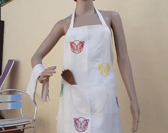 A bib apron, apron has bib, white linen with five embroidered butterflies and a pocket on the front