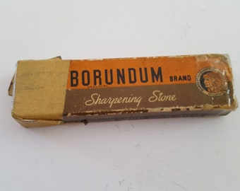 Vintage early Carborundum Sharpening Stone, cardboard sleeve in worn condition, the blade hone is used but in good condition.