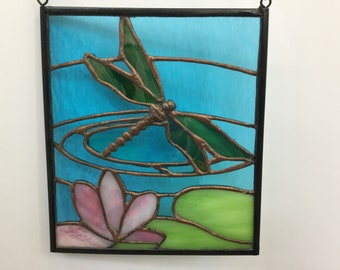 Stained glass panel Dragonfly in the water lilies.