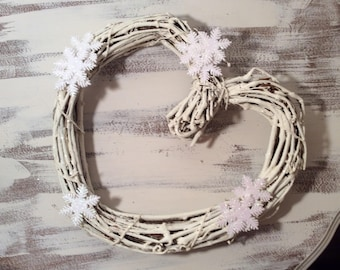 White heart shaped grapevine wreath adorned with sparkly snowflakes Christmas Winter