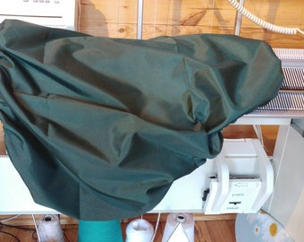 Reversable waterproof saddle cover