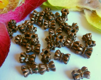 set of 50 beads in metal copper