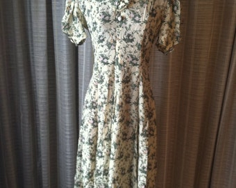 Vintage yellow dress with green leaves and pink flowers