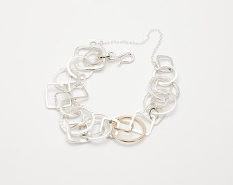 Albaicin by Fedha - organic collection of hand-forged square and circular links in sterling silver and rose gold, hammered, polished, satin